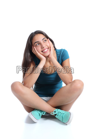teenager girl sitting and thinking looking