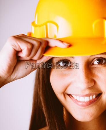 pretty woman wearing yellow protection helmet
