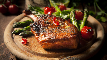 appetizing grilled veal loin on wooden