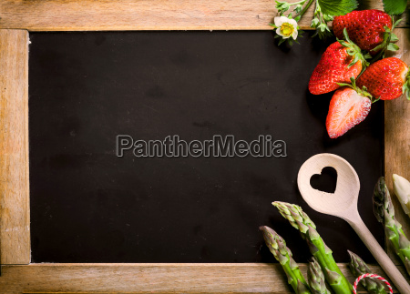 empty chalkboard with asparagus berries and