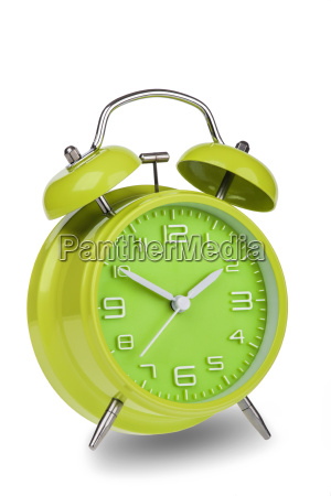 green alarm clock with the hands