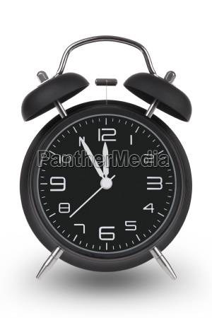 black alarm clock with hands at