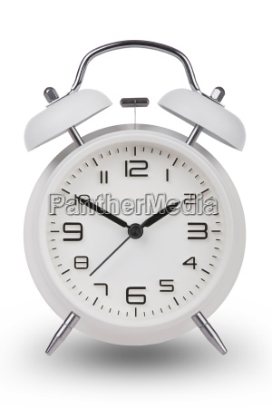white alarm clock with the hands