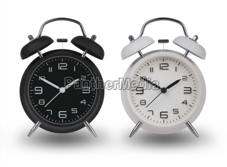 two alarm clocks with the hands