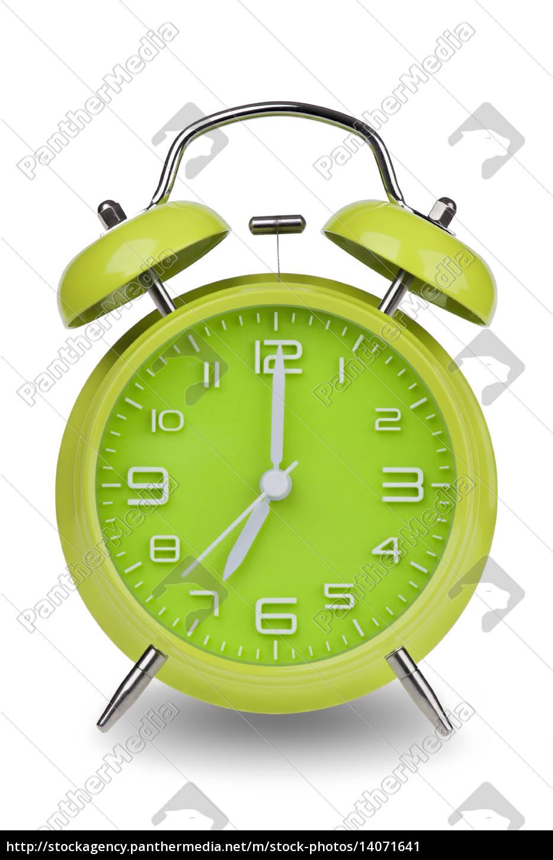 grüne, wecker, mit, den, händen, um - 14071641