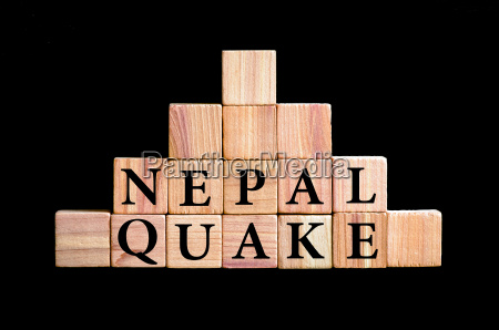 words nepal quake isolated on black