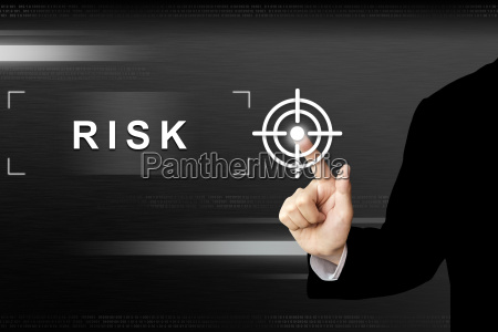 business hand pushing risk button on