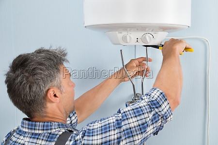 plumber installing water heater