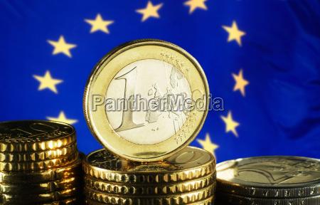 euro coin and european flag