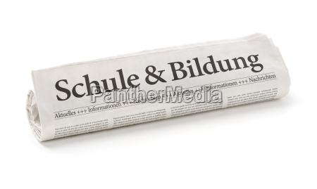 newspaper roll with the heading school