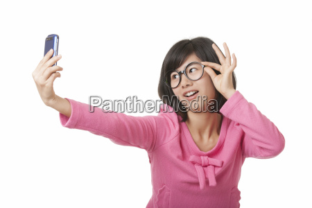 chinese woman taking a selfie isolated