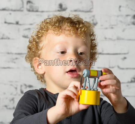 a little child plays with toy