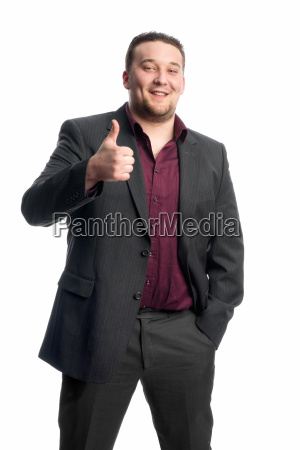 young man in suit shows thumbs