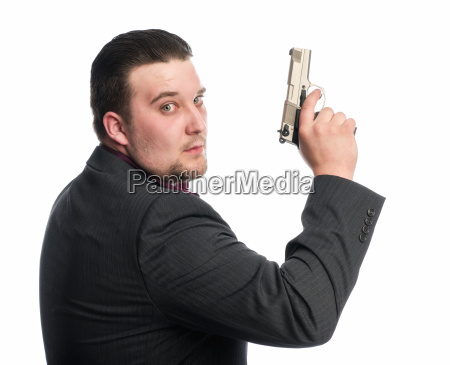 young man aiming with gun