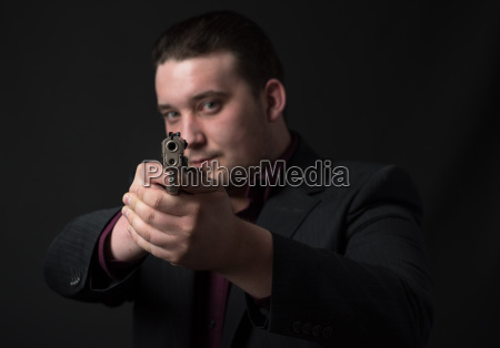 young man points a gun