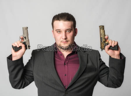 young man with two guns