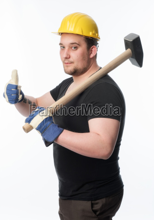 worker with sledgehammer showing thumbs up