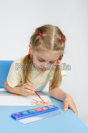 six year old girl sitting at