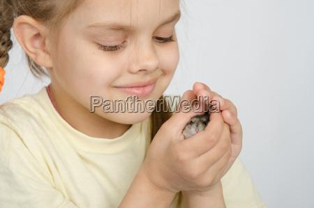 girl holding a hamster