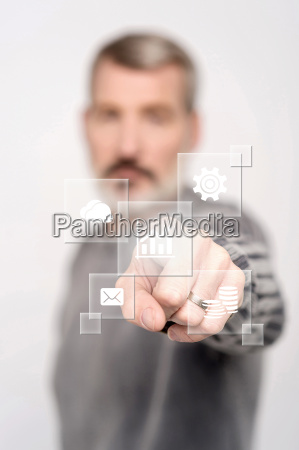 man pointing icons on virtual screen