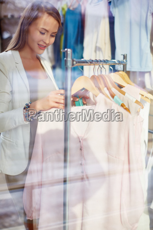 choosing blouse in boutique