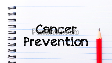 cancer prevention text written on notebook
