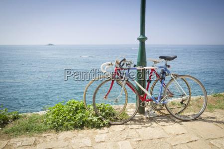 two bikes tied to pole