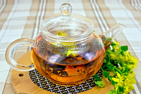 herbal tea from tutsan in glass