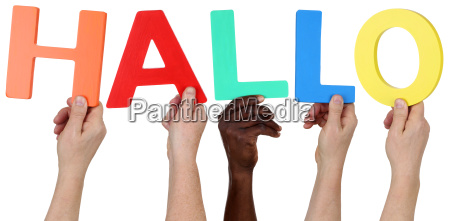 multicultural people group holding the word