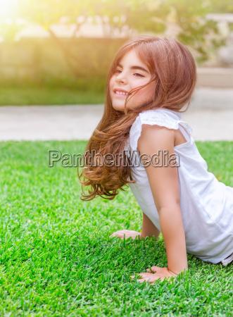 little girl doing push ups outdoors