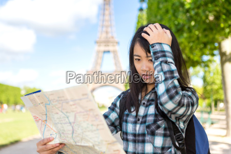 young attractive asian tourist lost in