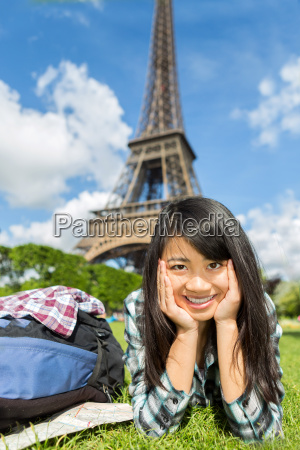 young attractive asian tourist enjoying her