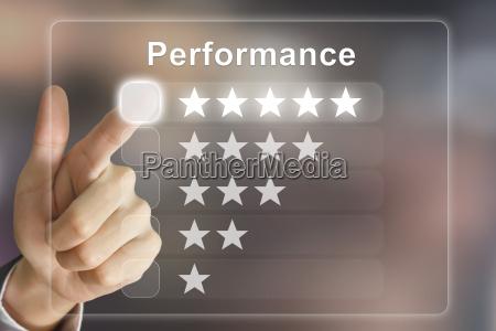 business hand pushing performance on virtual