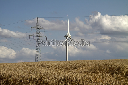 electricity pylon and wind turbine behind