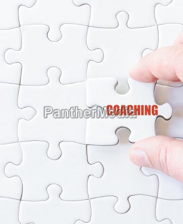 fehlende puzzle stueck mit wort coaching