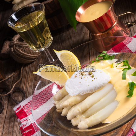 white asparagus served with hollandaise sauce