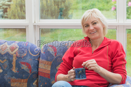 smiling blonde middle aged woman is
