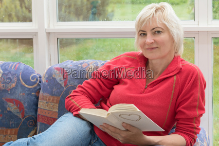 blonde middle aged woman is relaxing