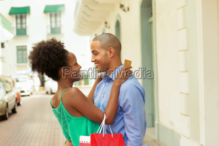 african american couple shopping with credit