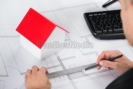 close up of architect making blueprint