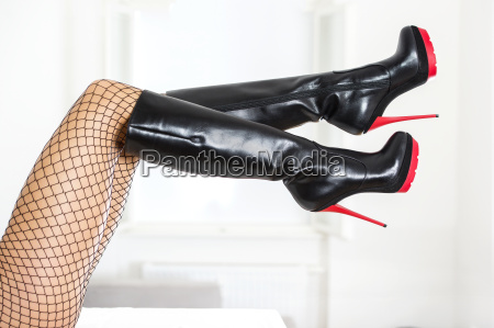legs in fishnet stockings and black