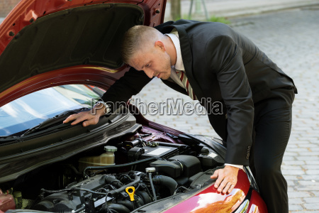 man watching the engine of a