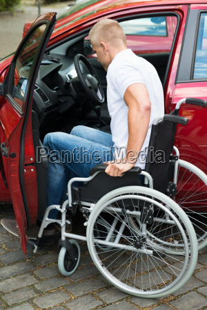 handicapped man boarding in his car