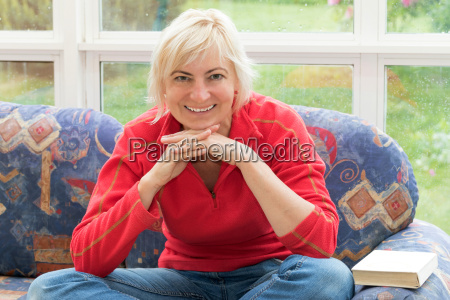 blonde middle aged woman is smiling
