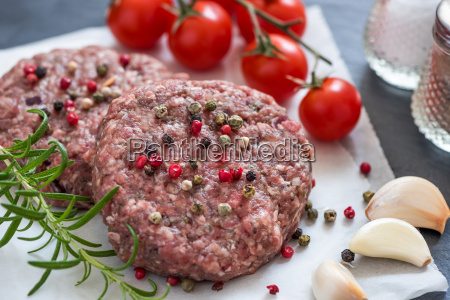 raw minced hamburger meat with herb