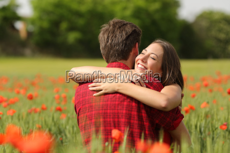 couple hugging after proposal in a