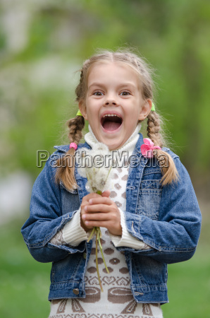 six year old girl with dandelions