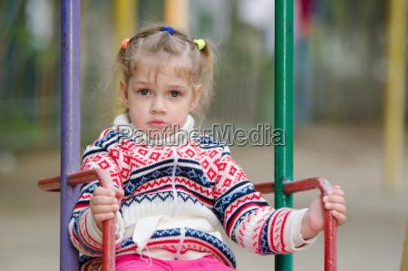 upset four year girl riding on