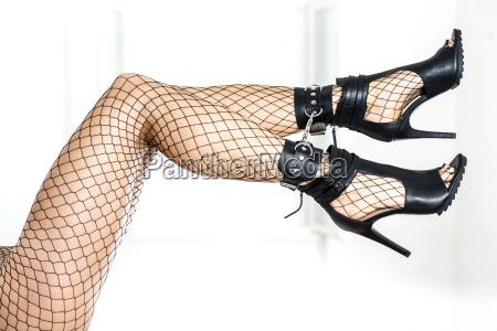 cuffed legs of a woman wearing