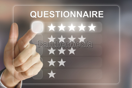 business hand pushing questionnaire on virtual